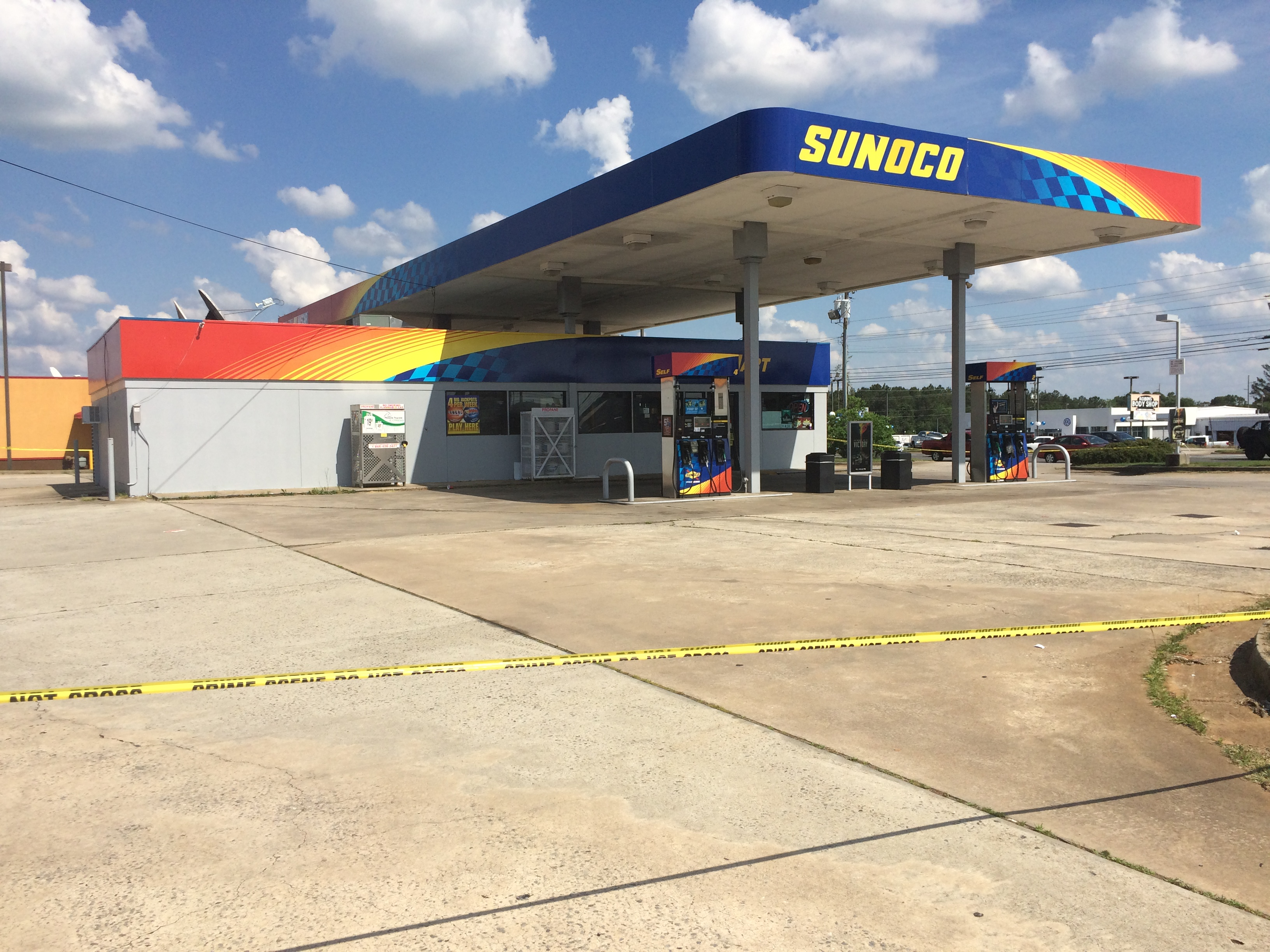 crime scene tape placed around some macon gas stations